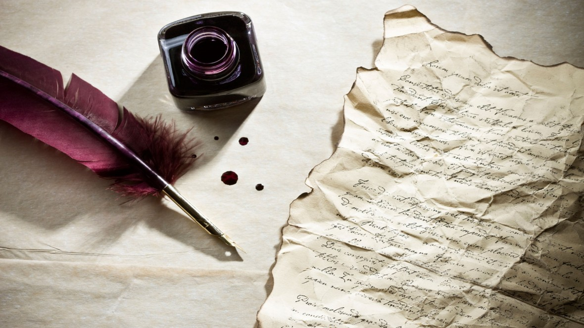 feather_pen_writing_letter_with_ink_bottle-hd